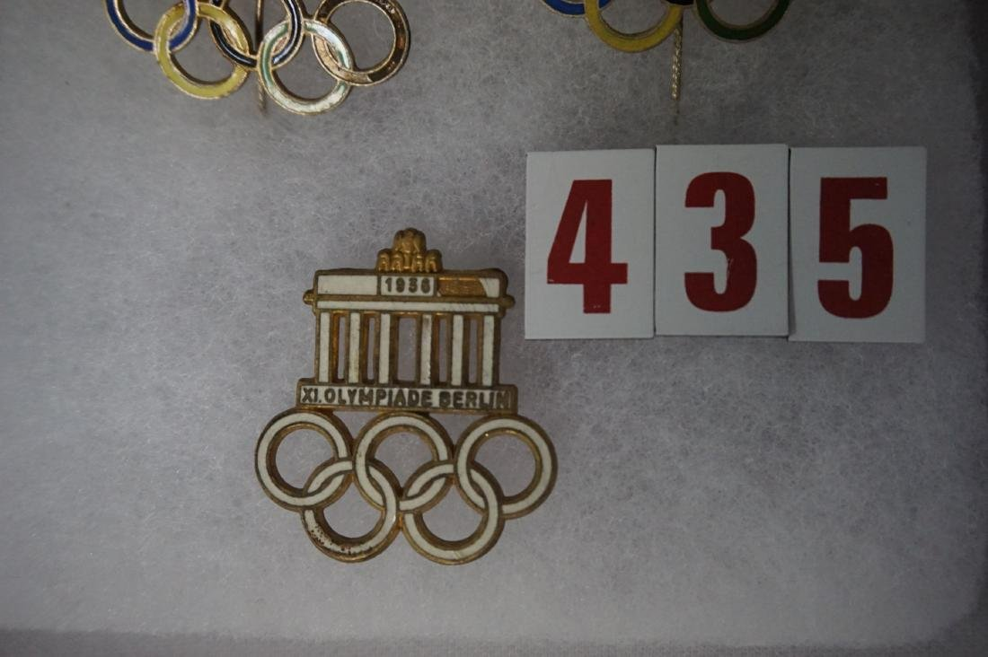 SMALL DISPLAY CASE WITH (7) OLYMPIC - 2