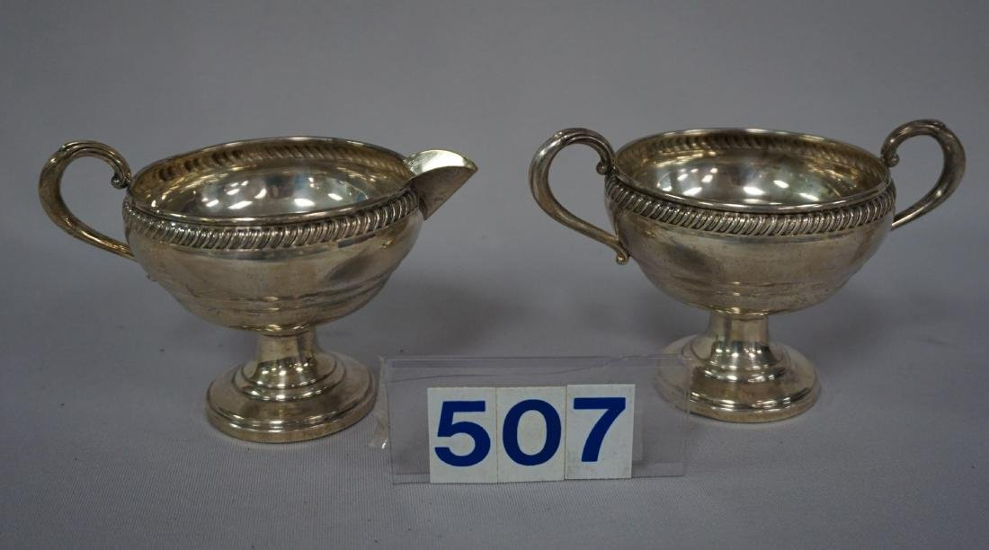 PAIR OF STERLING WEIGHTED SUGAR