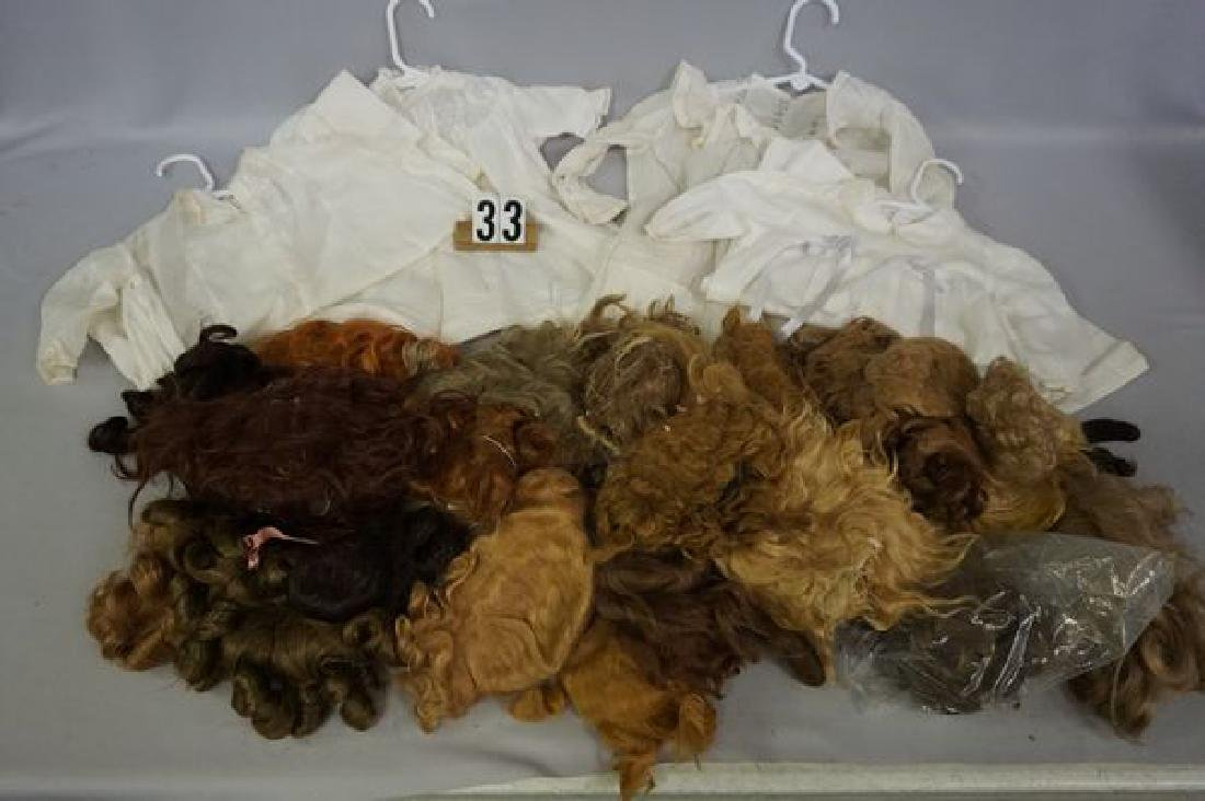 BOX OF ASSORTED SIZE & AGE DOLL WIGS -