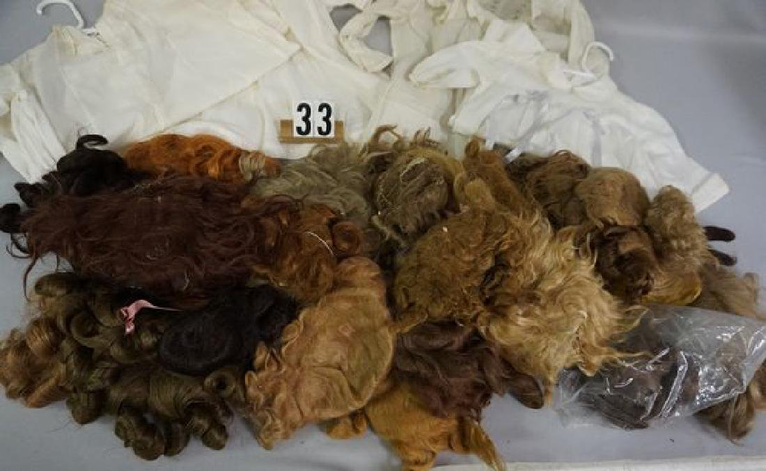 BOX OF ASSORTED SIZE & AGE DOLL WIGS - - 3