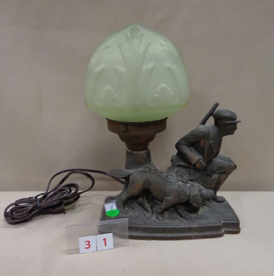 POT METAL LAMP, CIRCA 1920'S, WITH A HUNTER