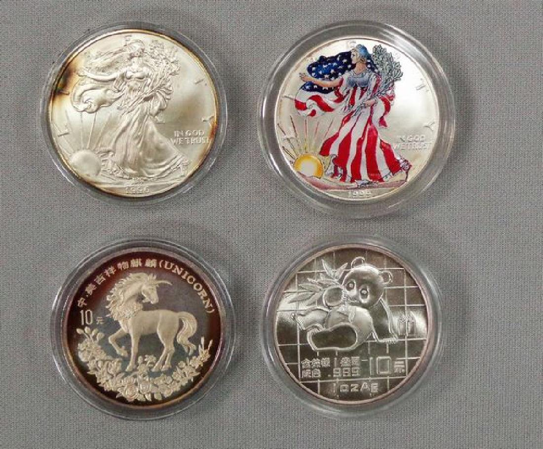 (2) SILVER EAGLES & (2) SILVER ROUNDS: