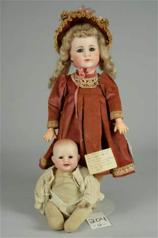 LOT OF 2 REPRODUCTION BISQUE DOLLS
