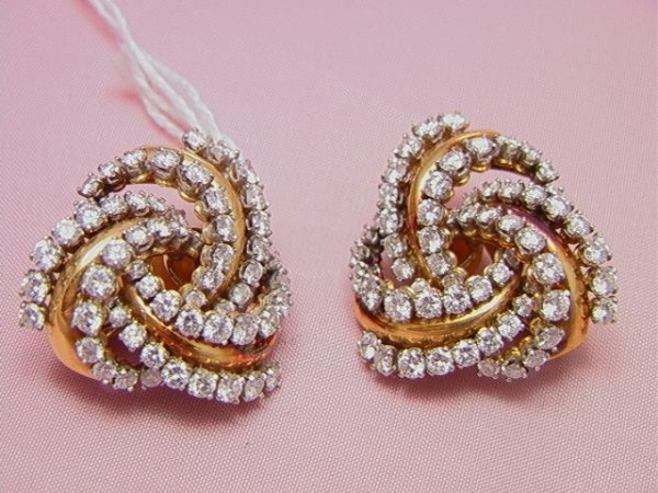 24: Gold and diamond knot earrings, tests 14K