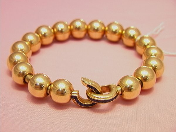 90: CARTIER, France 18K yellow gold bead, Bracelet