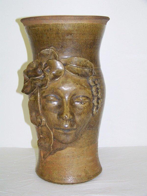 9: Early Pottery Face Jug / Vase