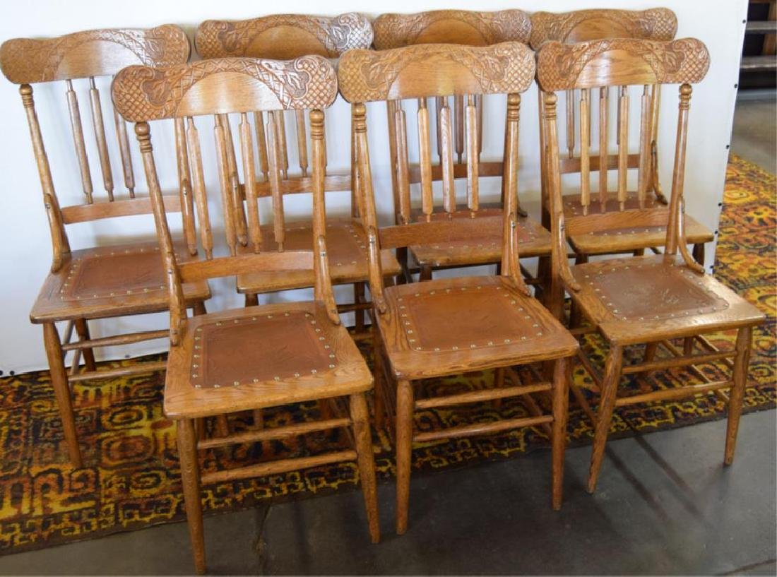 SEVEN MATCHING PRESSED BACK OAK CHAIRS