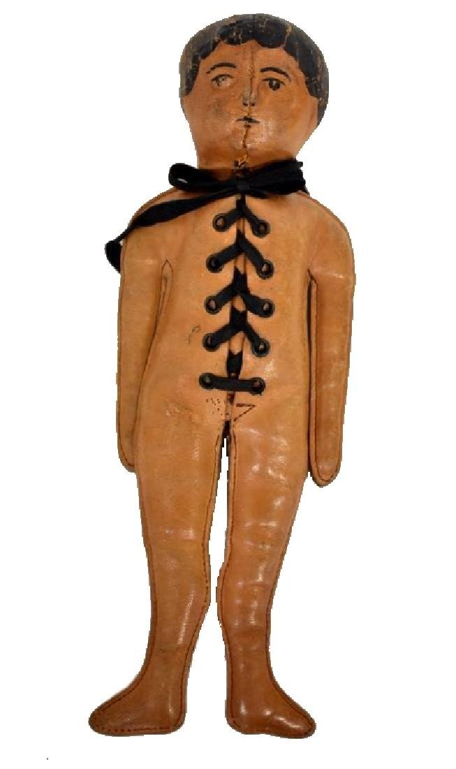 CIRCA 1900 LEATHER INDIAN DOLL