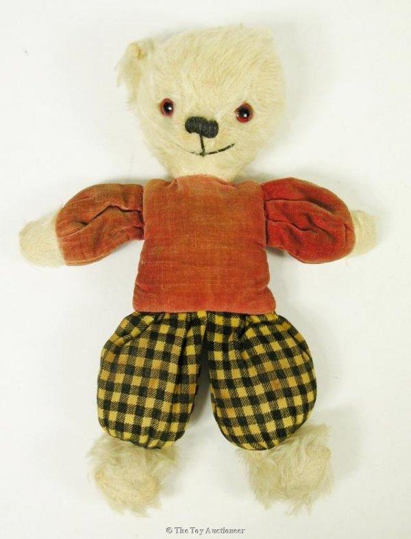 23: An unusual small dressed Teddy Bear