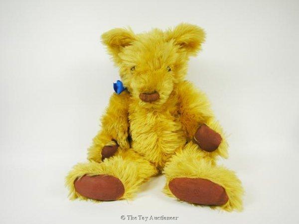 60: A large shaggy Invicta Teddy Bear