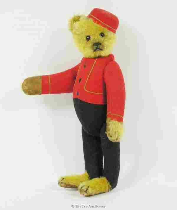 100: A rare Schuco yes/no Teddy Bear Bellhop