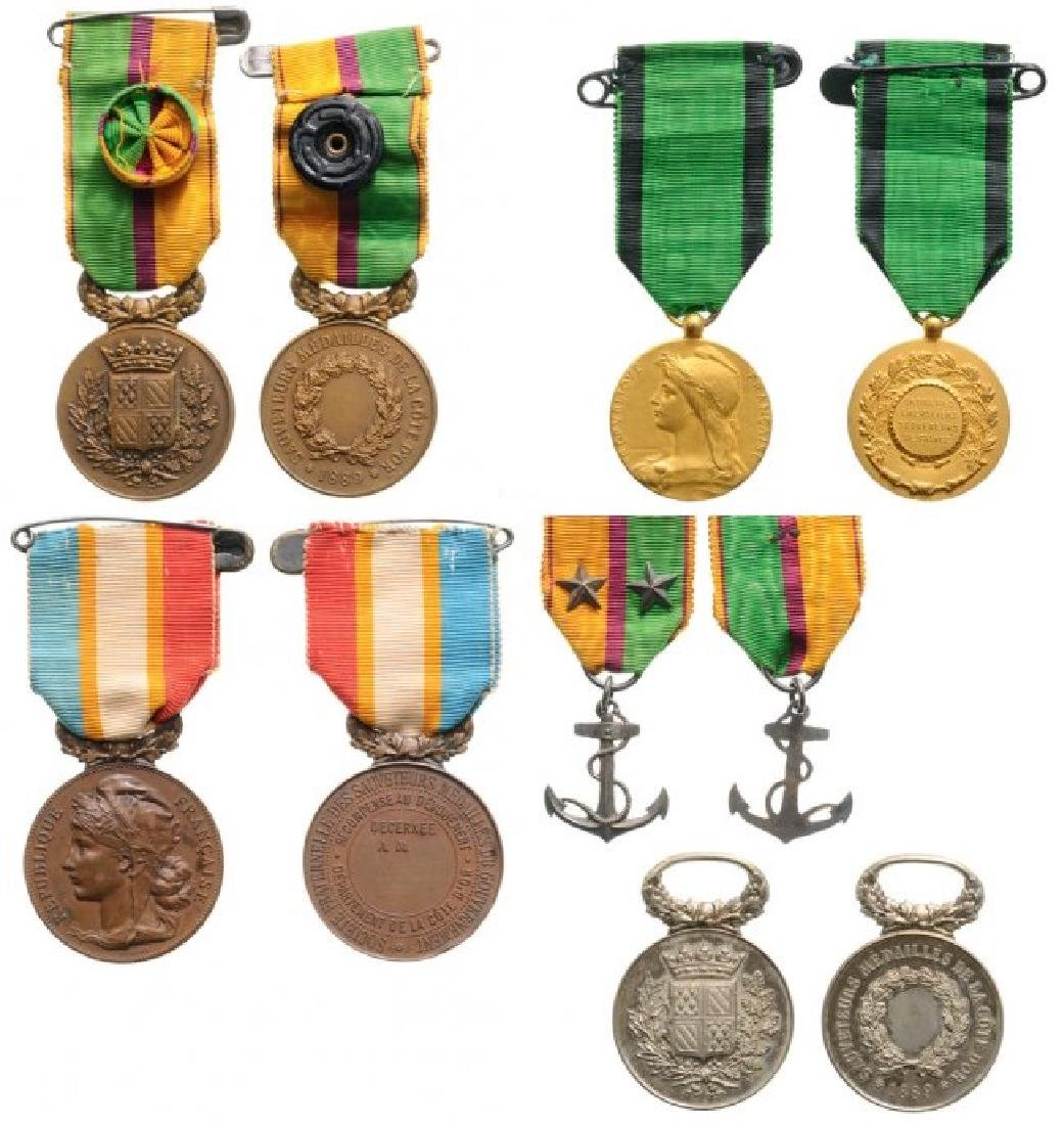 A Group of 5 Life Saving Medals