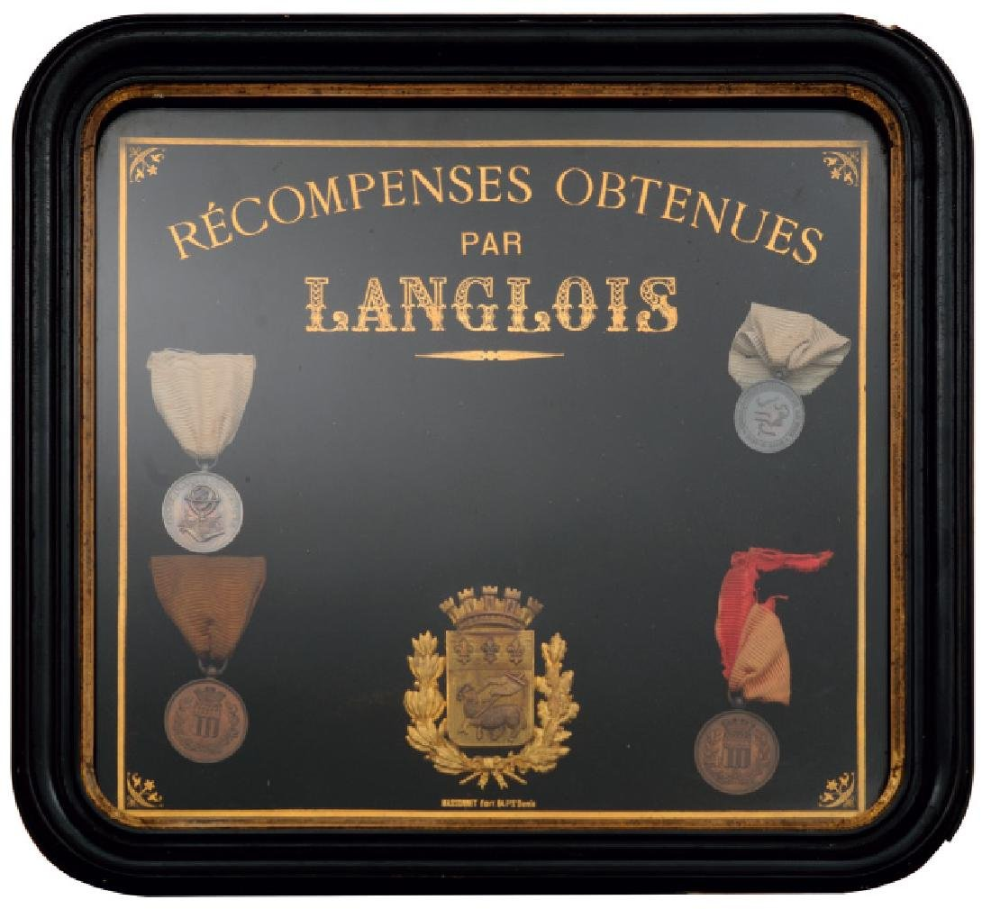 Frame containing 4 Medals of Education Societies