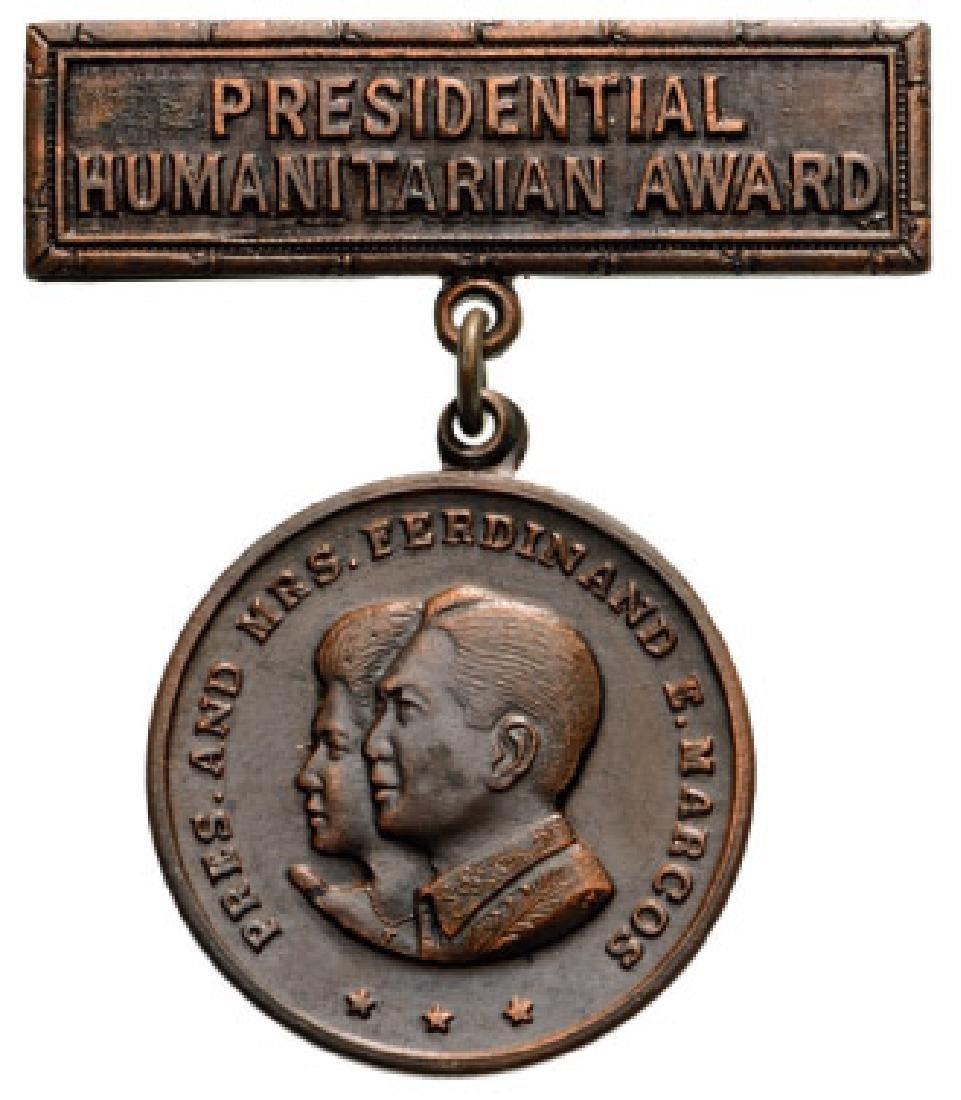 PRESIDENTIAL HUMANITARIAN AWARD, FERDINAND E. MARCOS