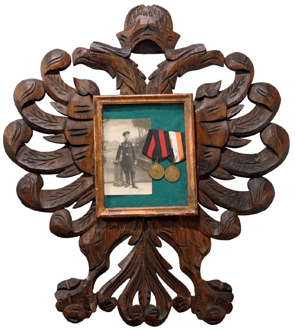Big sculptured eagle shaped wooden panel containing in