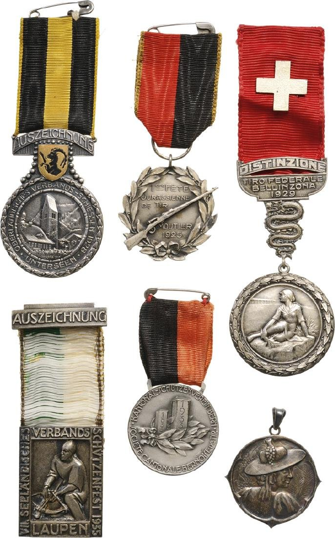 IMPORTANT LOT OF 9 SWISS MEDALS AND BADGES RELATED TO