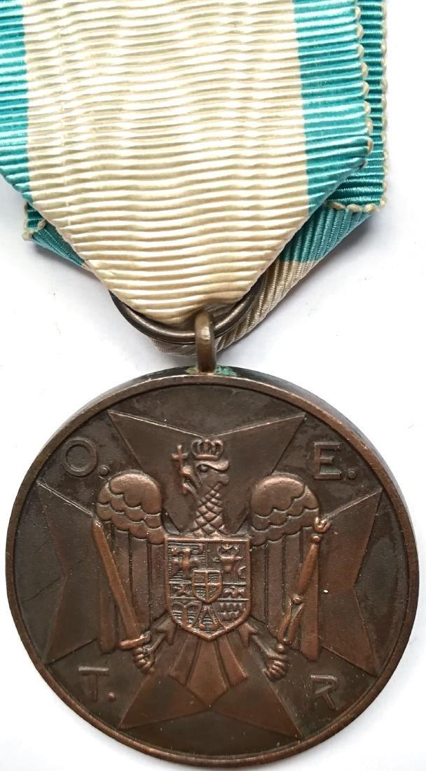 Civil Guard Medal, O.E.T.R. initials