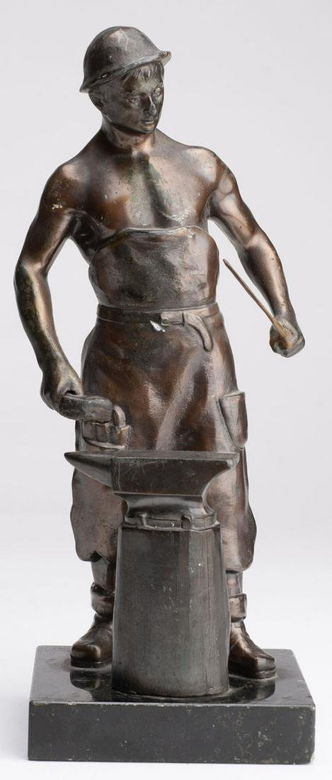 Dark bronze statue of the blacksmith at the forge