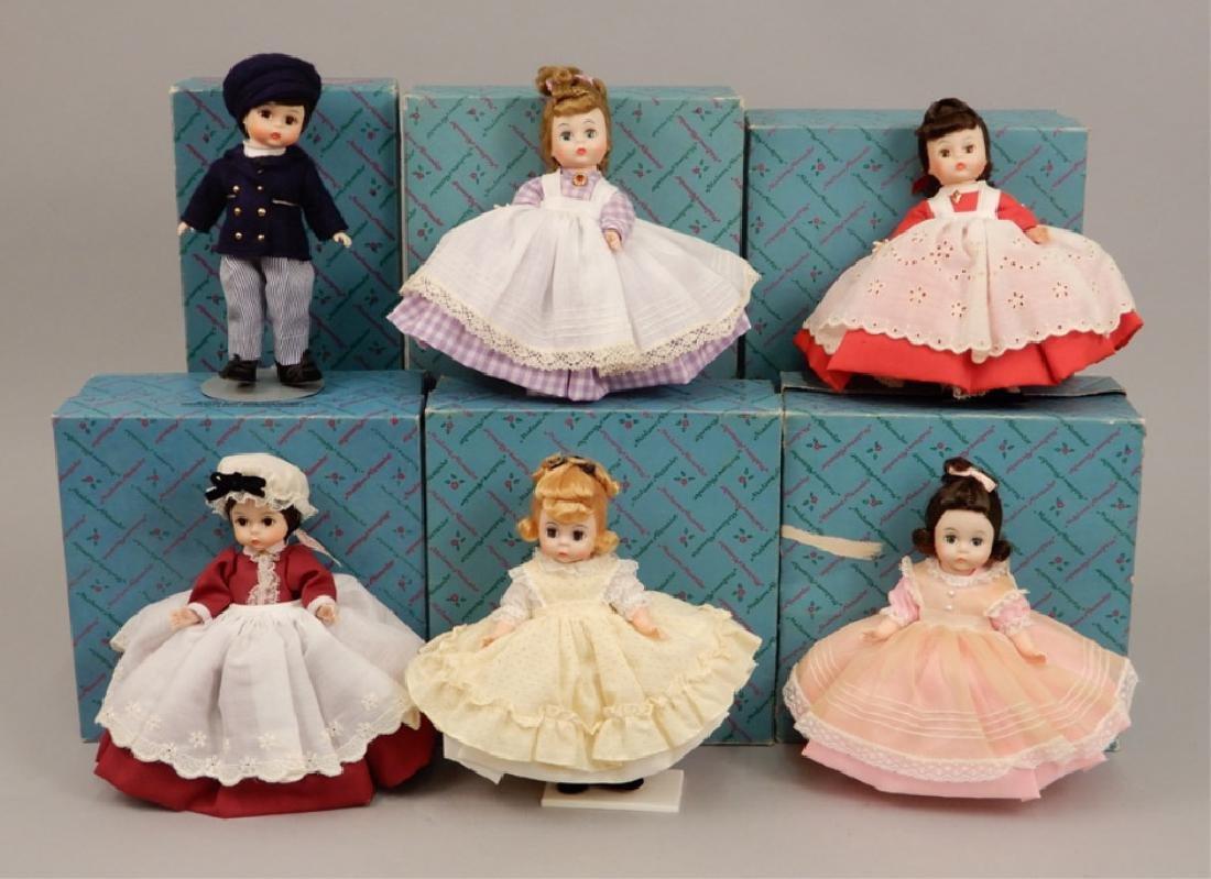 Six Madame Alexander Little Women dolls in boxes