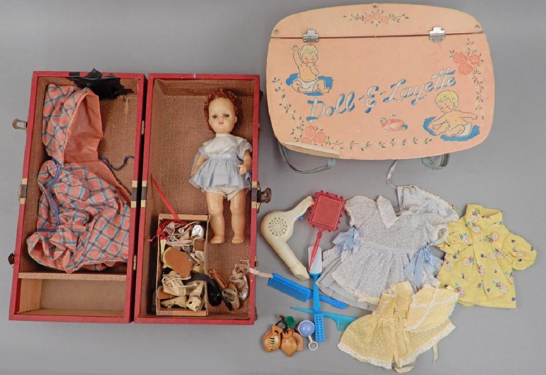 Terri Lee doll with clothes in trunk