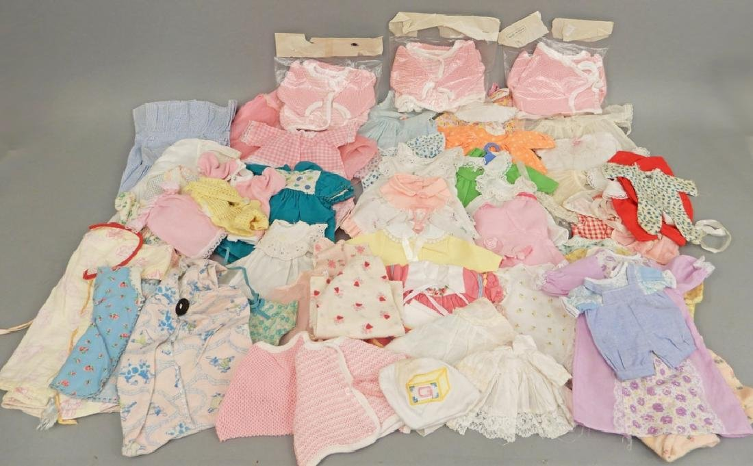 Large grouping of doll clothes