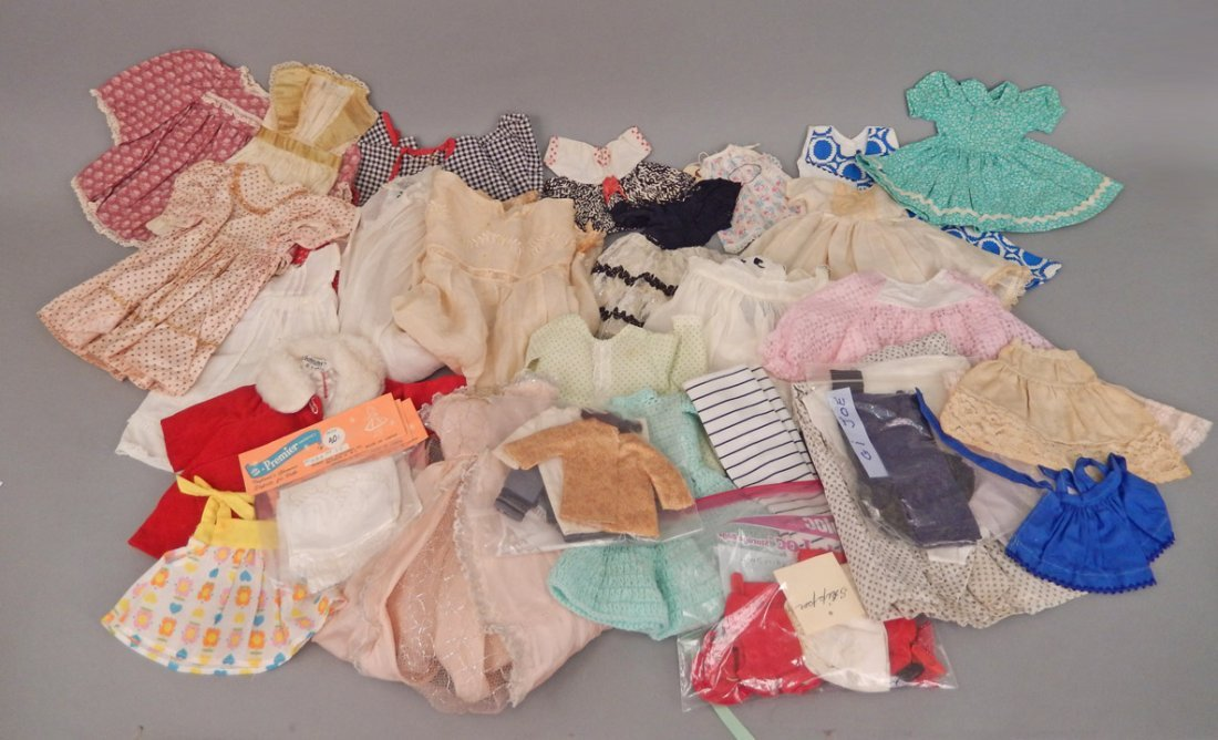 Large grouping of doll clothes, various sizes