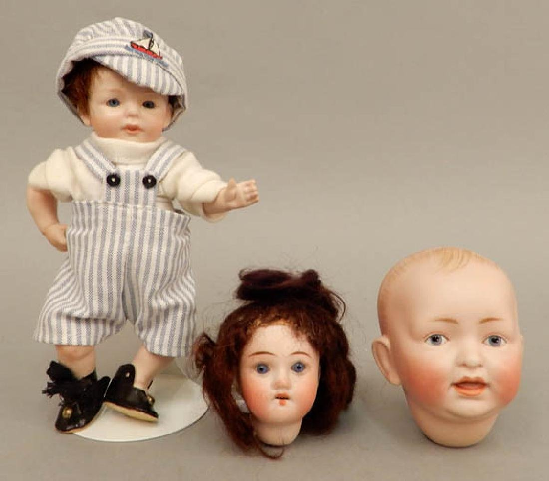 Two bisque doll heads and a Kestner bisque doll
