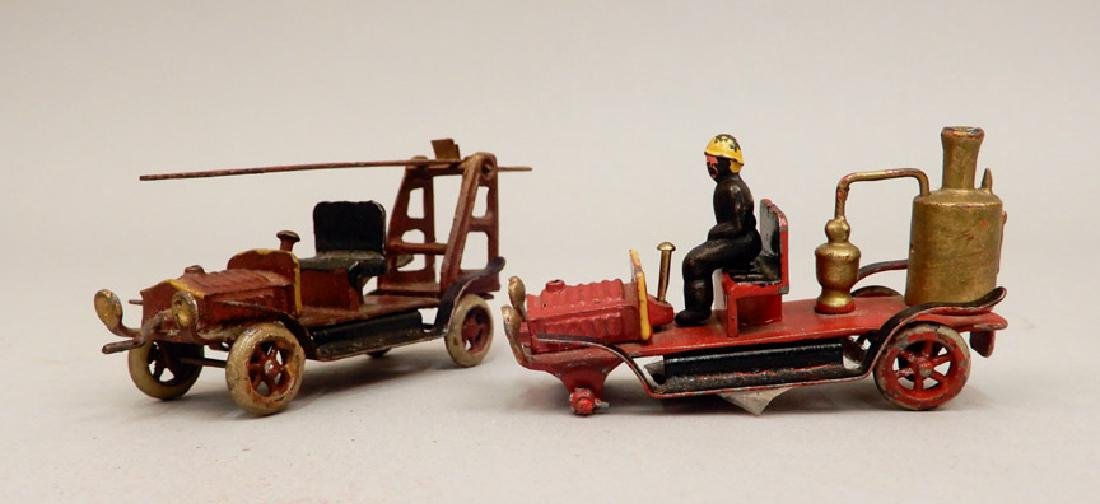 Two penny toy fire trucks