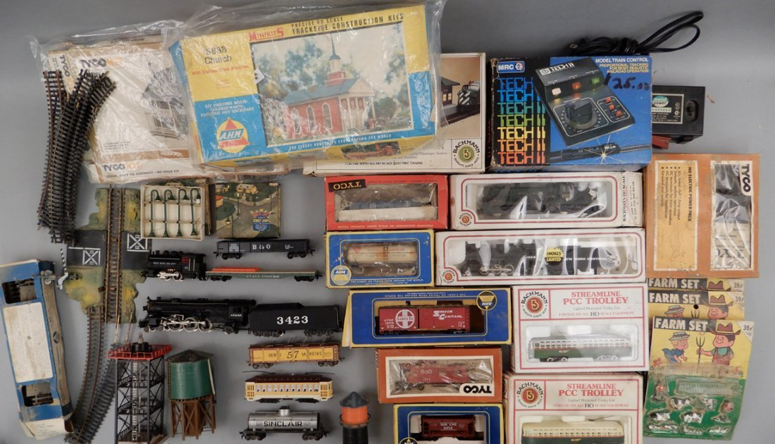 Collection of HO scale model trains and buildings