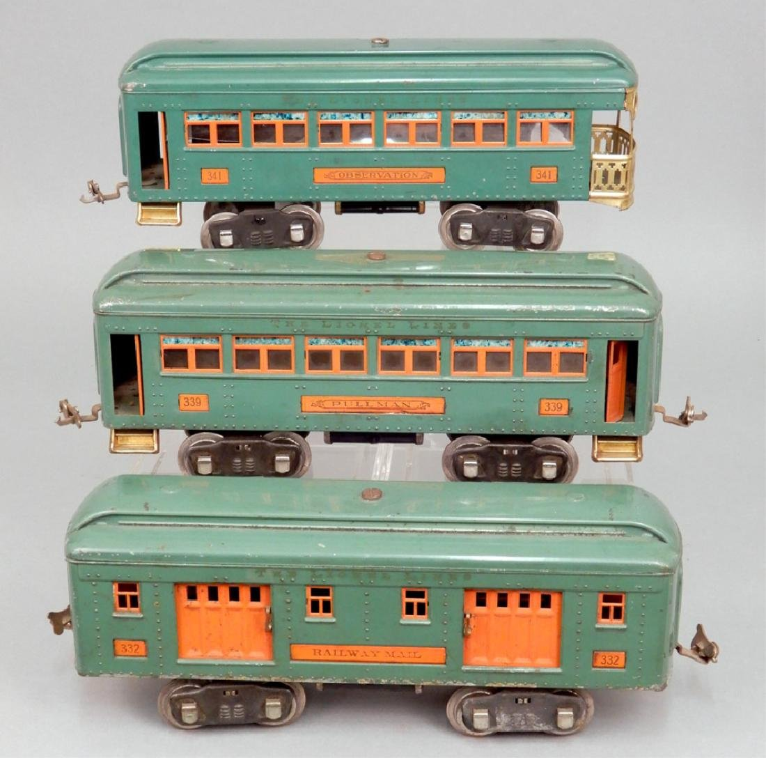 Three Lionel standard gauge passenger cars
