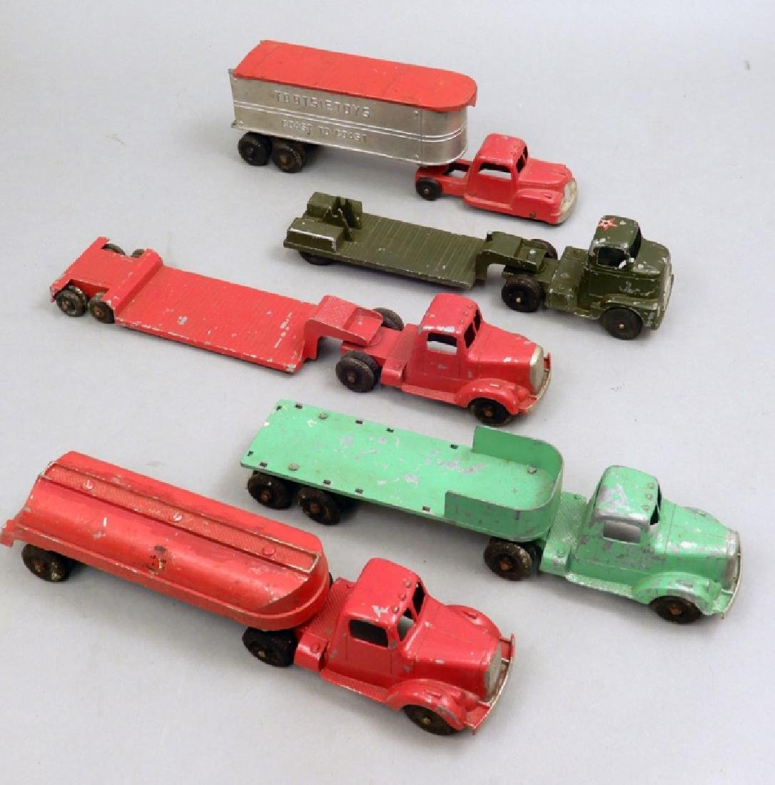 Five Tootsietoys diecast trucks and trailers