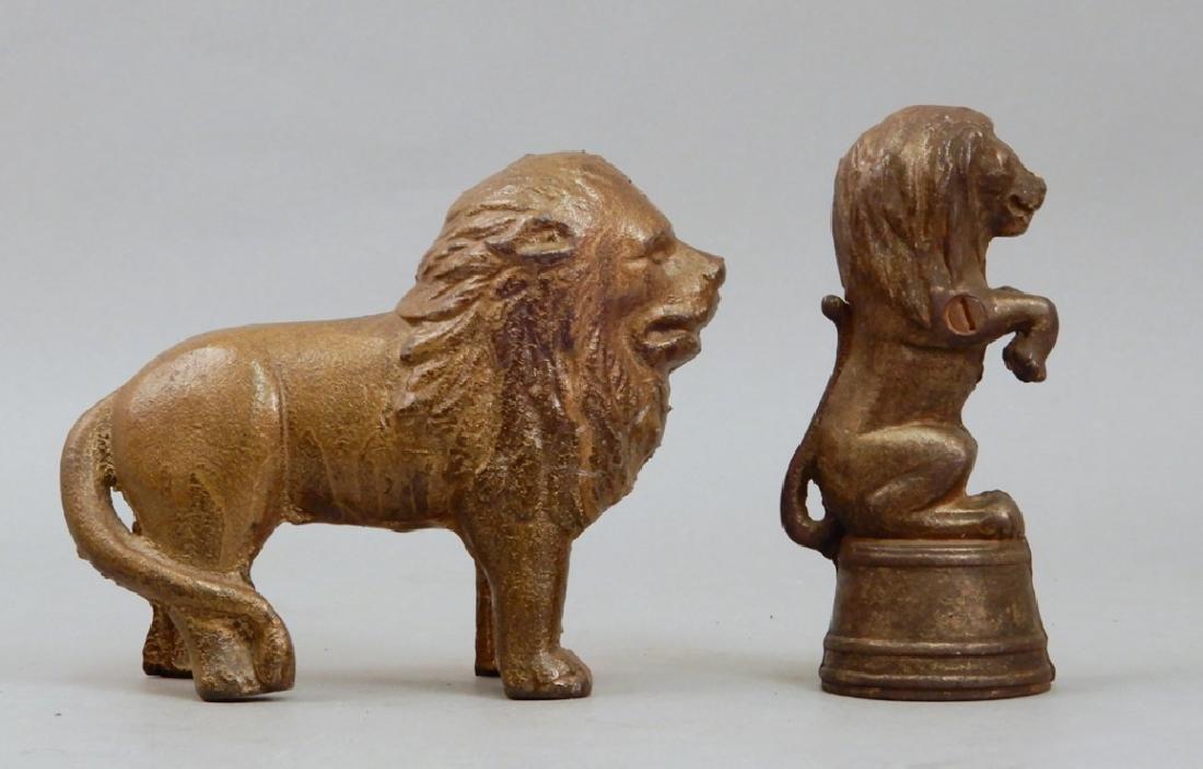 Two AC Williams cast iron lion still banks