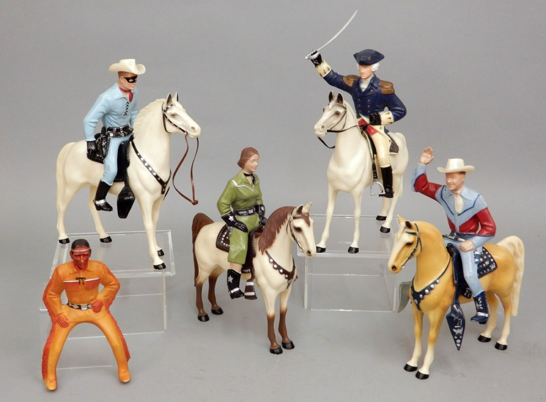 Collection of Hartland figurines and horses