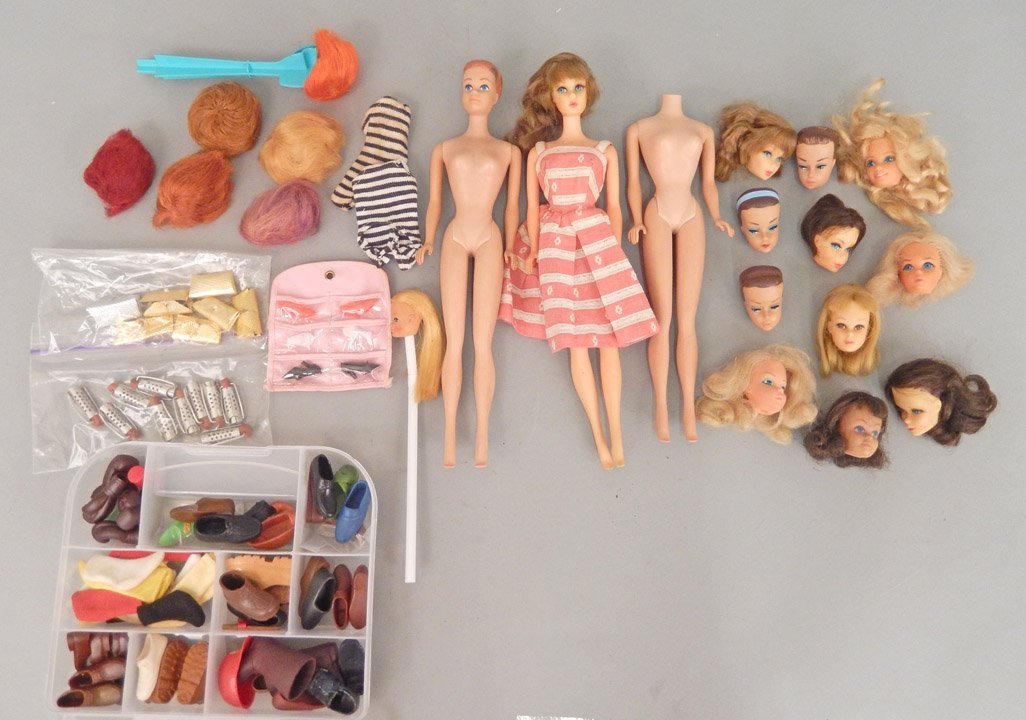 Grouping of Barbie dolls, Barbie heads, and shoes