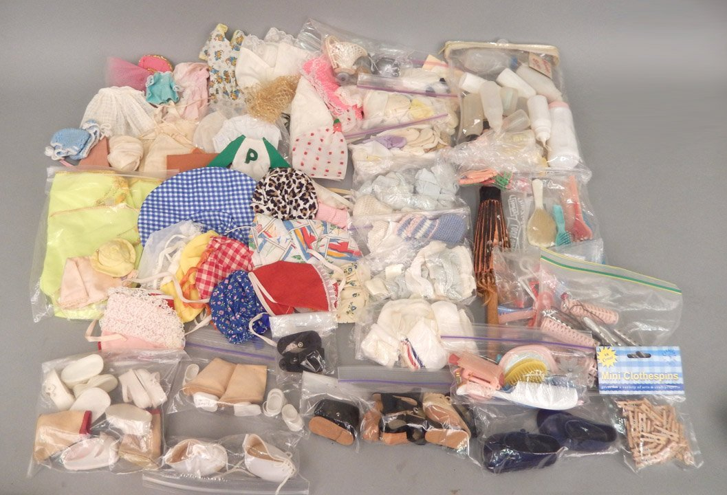 Large grouping of doll clothes and shoes