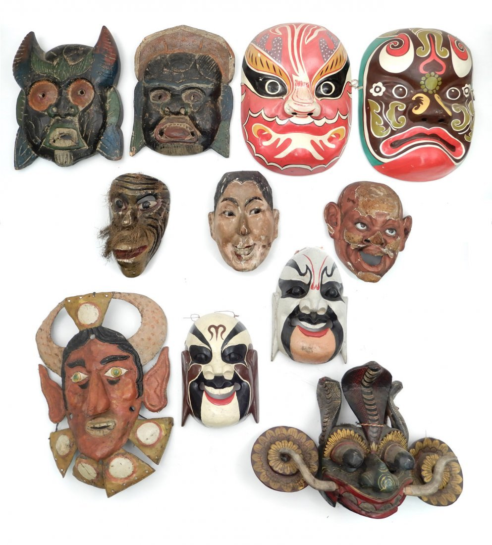 Grouping of ethnic and Asian masks, eleven pieces