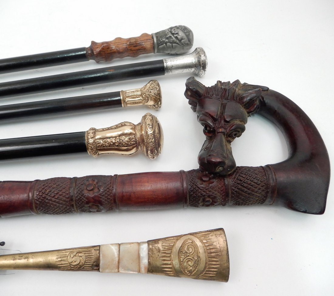 Grouping of walking sticks and Victorian parasol
