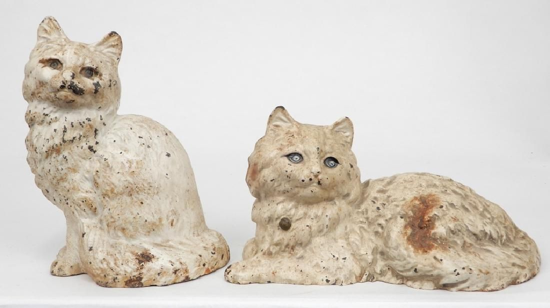 Two Hubley white cat cast iron doorstops