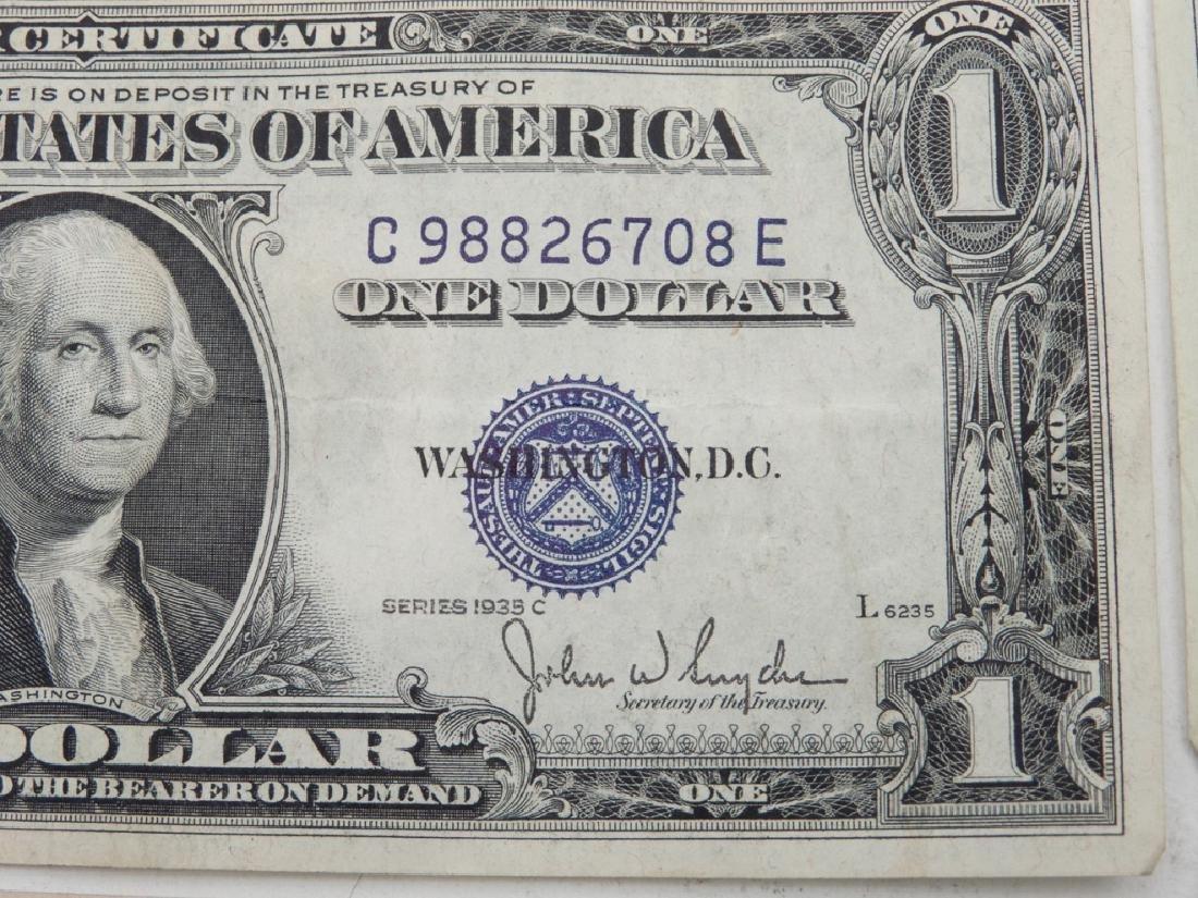 Twenty-one $1.00 silver certificates - 3