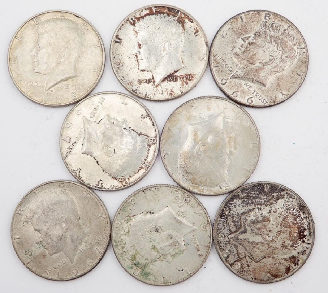 Eight silver Kennedy half dollars