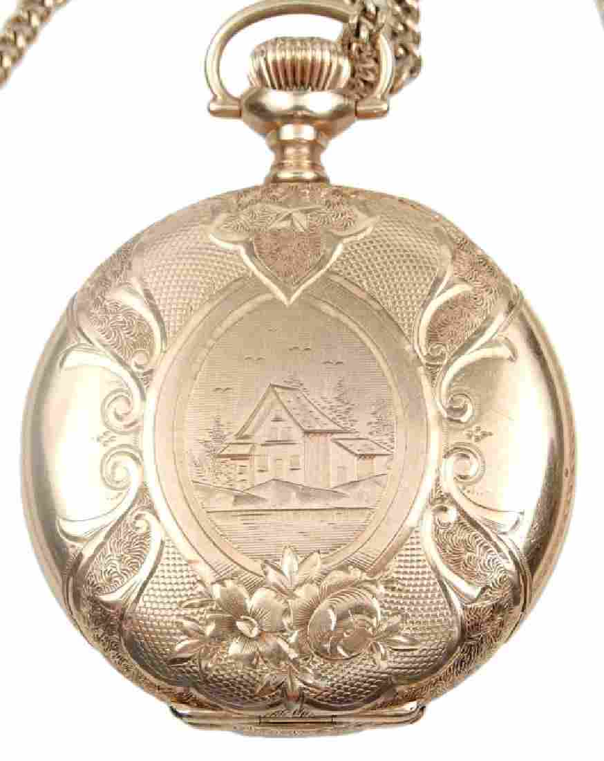 Lady's 14k gold pocket watch and chain