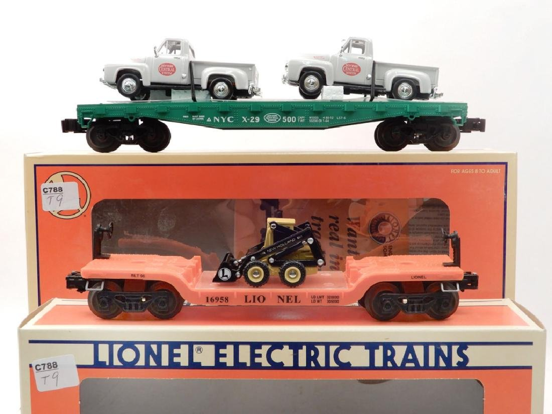 Two Lionel freight cars in boxes