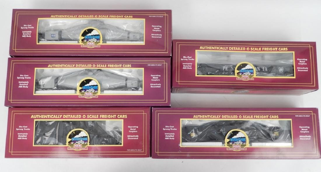 Five MTH freight cars in original boxes