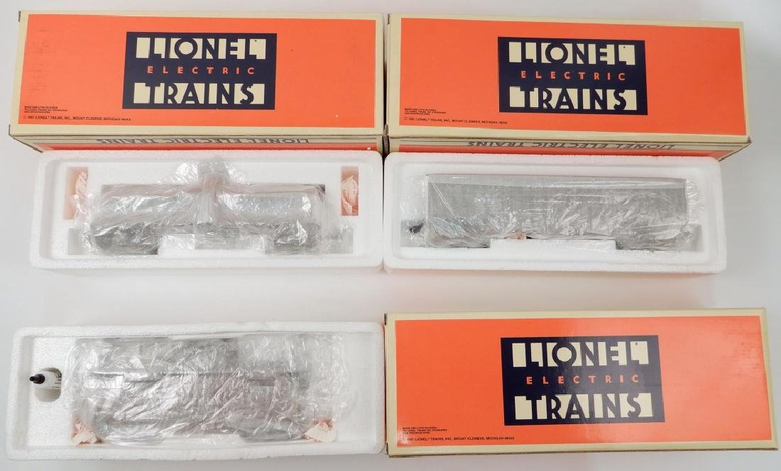 Three Lionel freight cars in original boxes