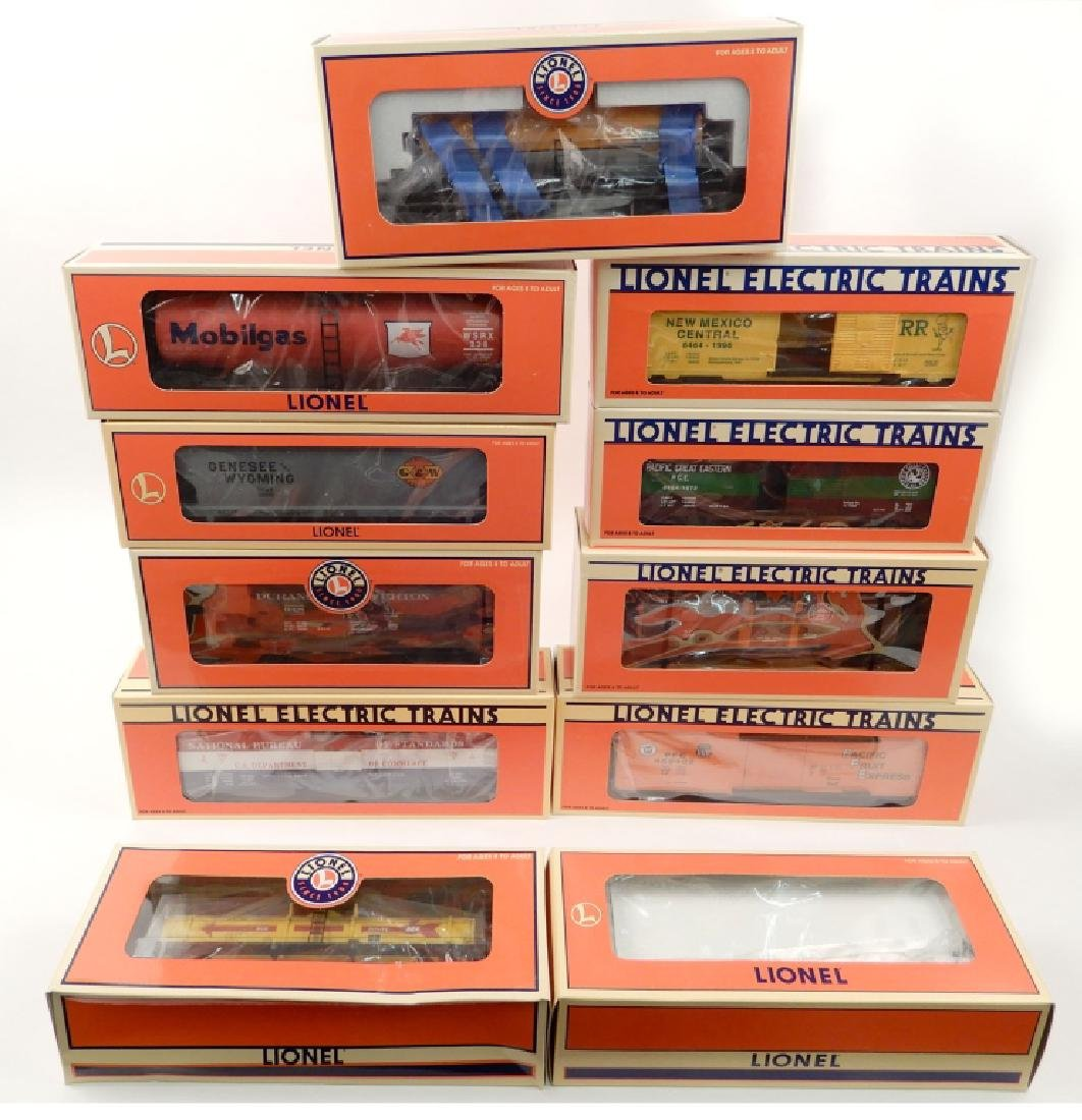 Eleven Lionel TTOS freight cars in original boxes