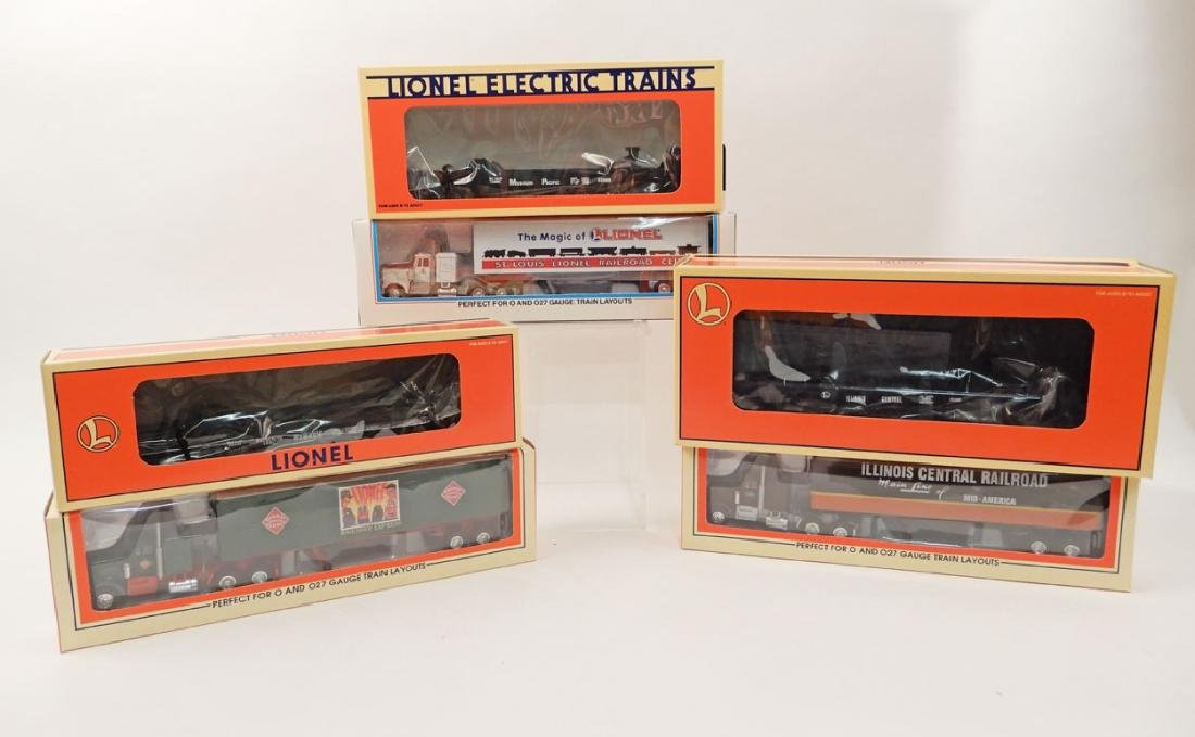 Three Lionel LRRC tractor and trailer sets in boxes