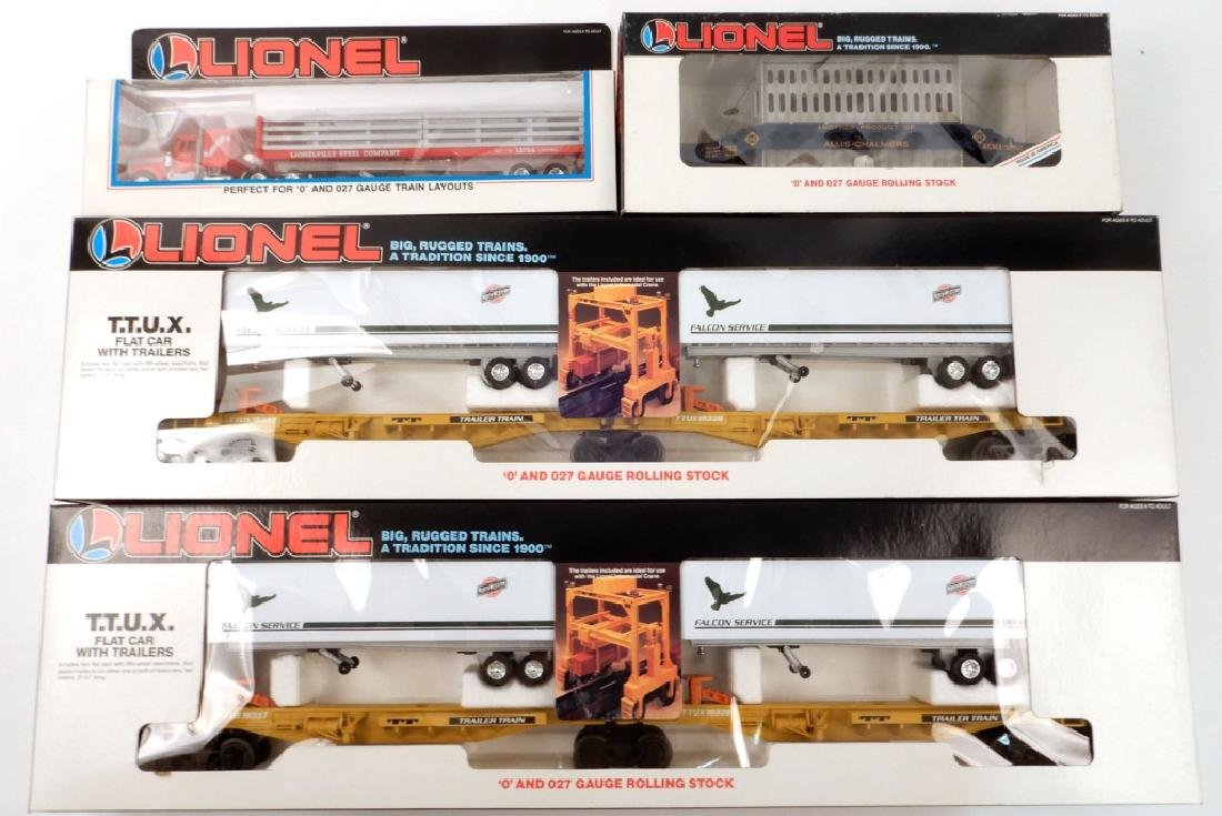 Four Lionel freight cars and tractor in boxes