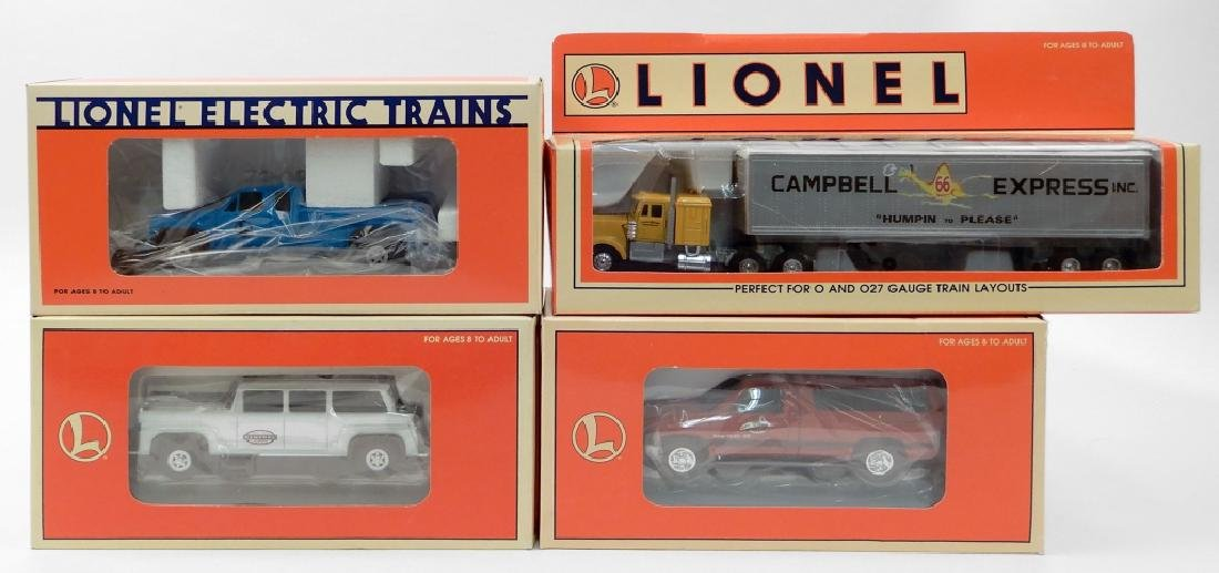 Four Lionel vehicles in original boxes