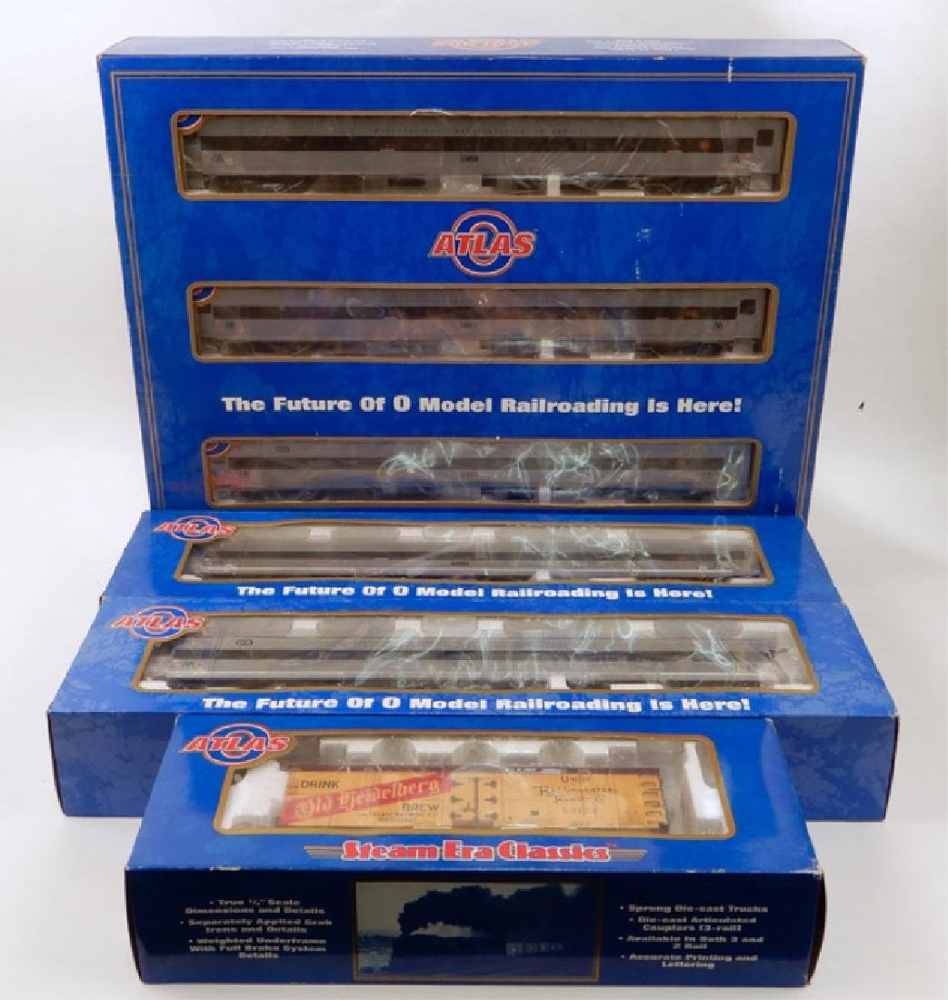 Six Atlas passenger and freight cars in original boxes