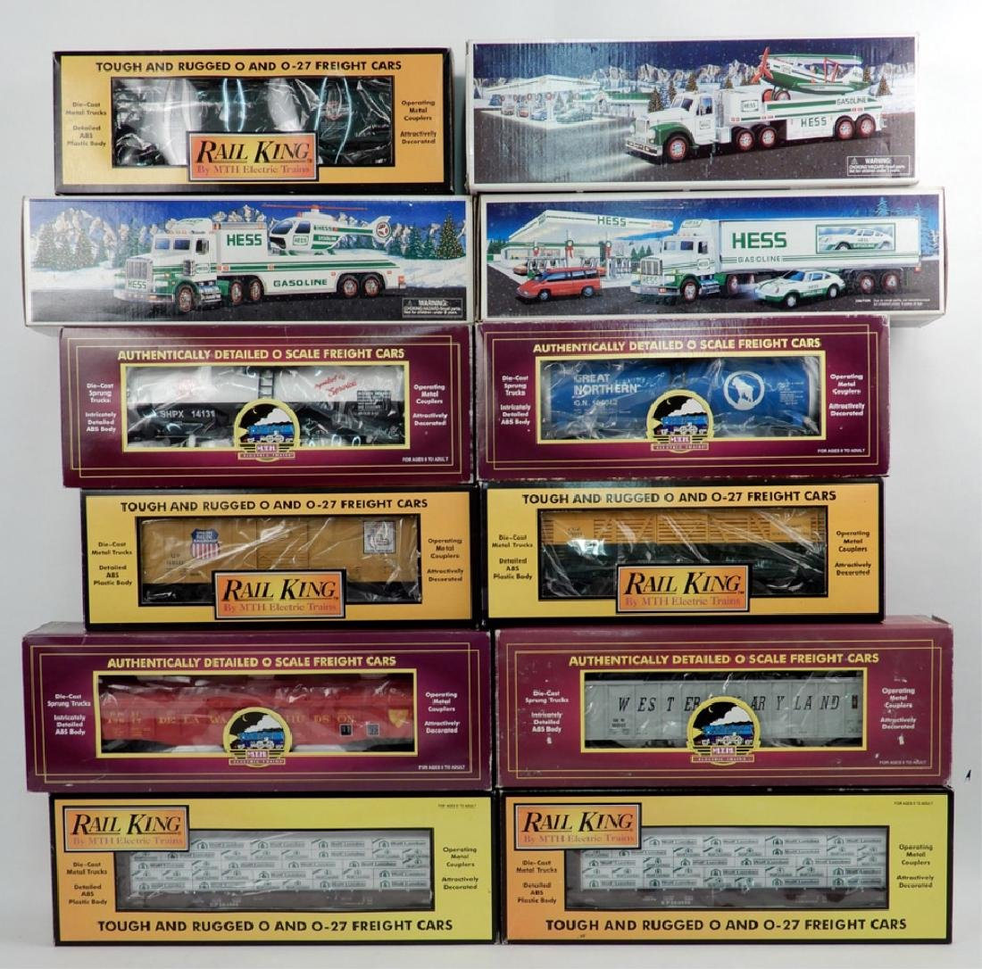 Nine MTH and Rail King freight cars and three Hess